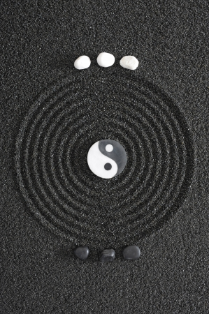 japanese zen garden with yin and yang stones photo