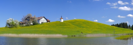 panorama landscape in bavaria with chapel and farm house on lake Stock Photo - 20466267