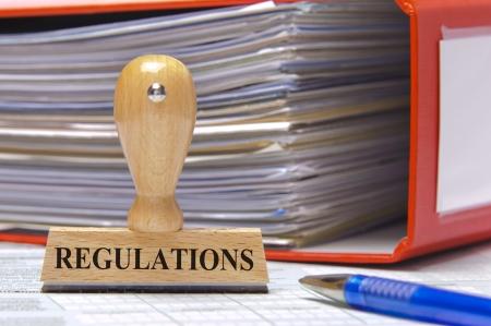 regelgeving aangegeven op rubber stempel Stockfoto