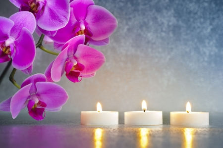 Japan zen garden with orchid and candle lights photo