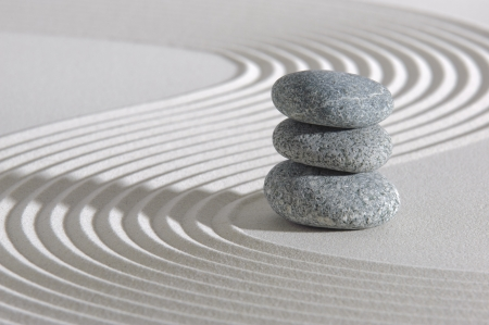stone circle: Japanese zen garden with stone in sand Stock Photo