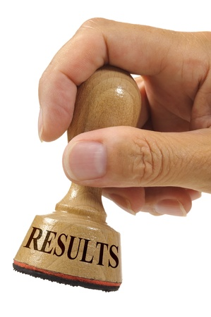 results marked on rubber stamp Stock Photo