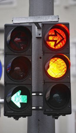 traffic lights with red and green arrows