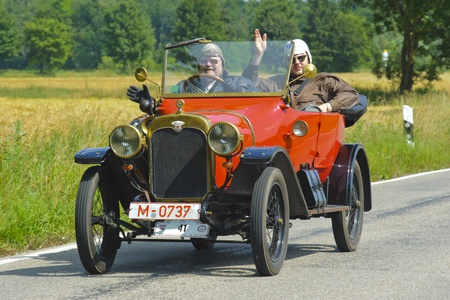 LANDSBERG, GERMANY - JULY 13: Oldtimer rallye for at least 80 years old antique cars with Wanderer W8 Open Tourer, built at year 1911, photo taken on July 13, 2013 in Landsberg, Germany