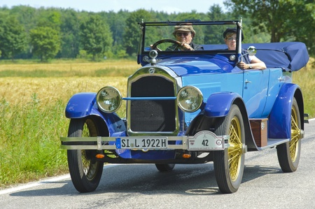 LANDSBERG, GERMANY - JULY 13: Oldtimer rallye for at least 80 years old antique cars with Studebaker Special Six Tourer, built at year 1922, photo taken on July 13, 2013 in Landsberg, Germany