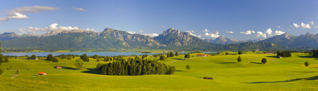 panorama view over rural landscape in Bavaria with alps mountains and lake Forggensee photo