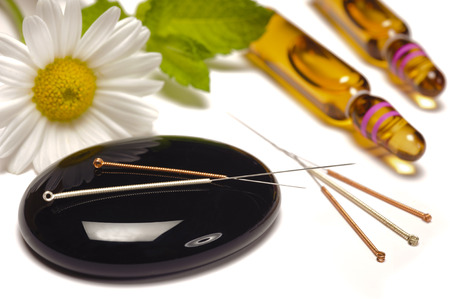 alternative medicine with acupuncture needles photo