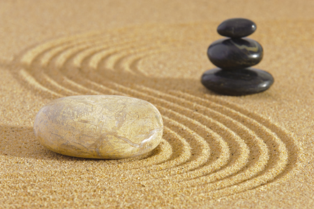 Japan ZEN garden in sand with stone photo