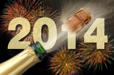 飛び出るシャンパンと花火で新年 2014 写真素材