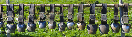 group of cow bells on fence in Bavaria photo