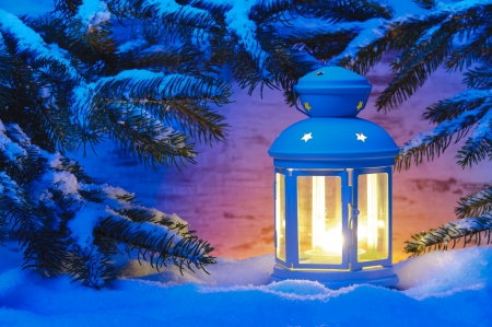 christmas landscape: candle light lantern in snow