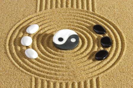 balance life: japanese zen garden with yin and yang stones
