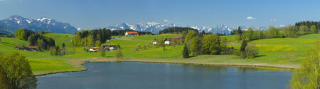 panorama landscape with lake Grabensee in Bavaria at sunny summer day with alps mountains photo
