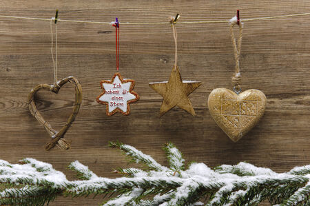 xmas decoration hanging on wooden wall photo