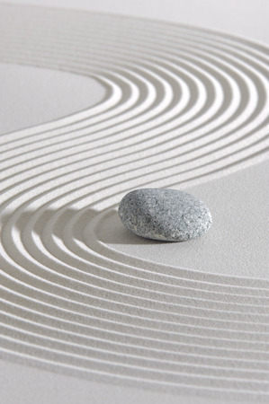 Japanese ZEN garden with stone in raked white sand