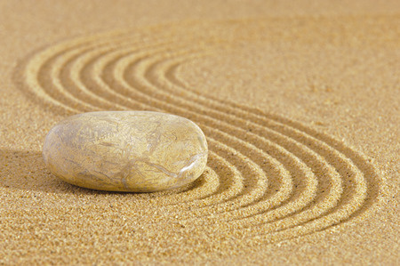 Japanese ZEN garden with stone in raked sand photo