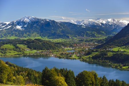 rural panorama landscape with lake Alpsee and alps mountains in Bavaria, Germany, nearby city Immenstadt