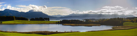 rural panorama landscape with lake Forggensee and alps mountains in Bavaria, Germany, nearby city Fuessen photo