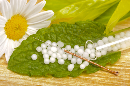 alternative medicine with acupuncture and homeopathy with herbal pills photo