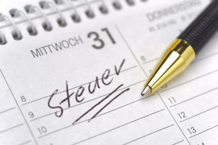 german tax day marked on calendar- tax in german Steuer