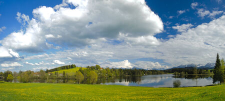 rural panorama landscape with lake and alps mountains in Bavaria, Germany, nearby city Fuessen photo