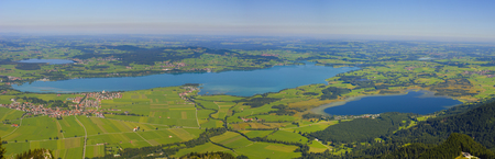 panorama landscape in Bavaria, with lake Forggensee and alps mountains nearby city Fuessen photo