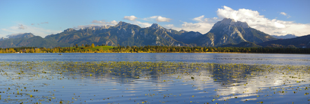 panorama landscape in Bavaria, with lake Forggensee and alps mountains photo