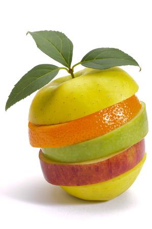 stack of sliced fresh mixed fruits over white  Standard-Bild