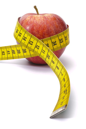weight control: apple with measure tape as symbol for diet and weight control Stock Photo