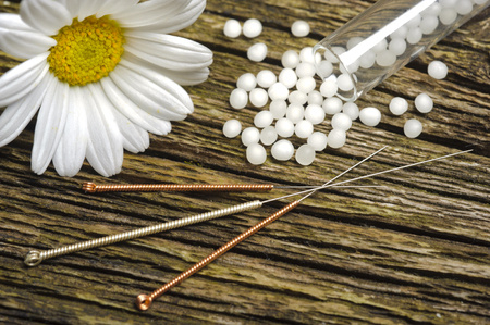 alternative medicine with herbal pills and acupuncture photo
