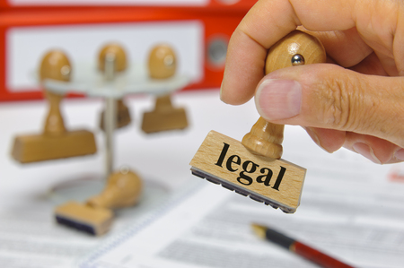 guideline: legal marked on rubber stamp in hand