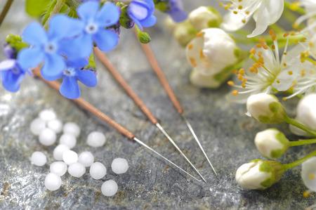 alternative medicine with herbal pills and acupuncture Stock Photo