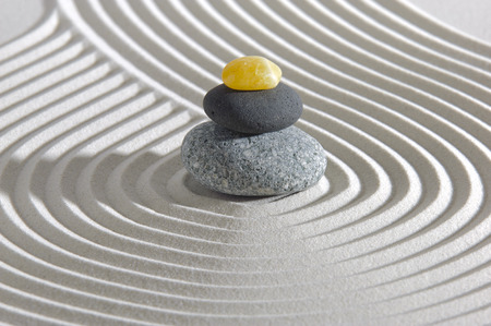 Japanese ZEN garden with stacked stones in sand photo