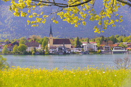 panorama landscapeof lake Tegernsee in Bavaria at city Rottach-Egern and its church photo