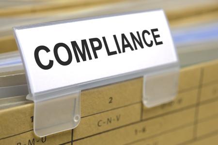 compliance marked on folder Standard-Bild