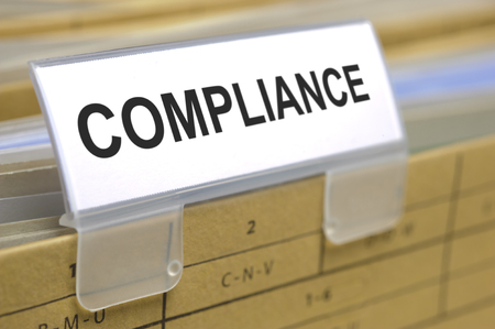 compliance: compliance marked on folder Stock Photo