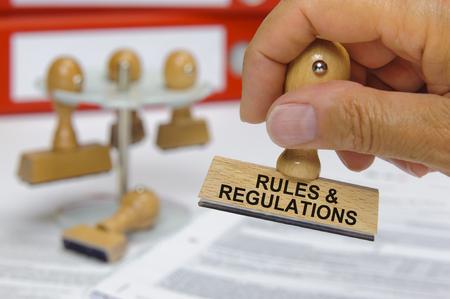 norme e regolamenti segnati sul timbro di gomma Archivio Fotografico