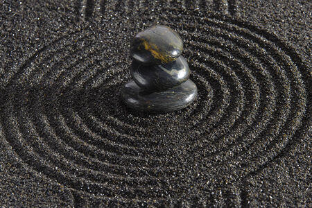 Japanese garden with stacked stones in sand photo