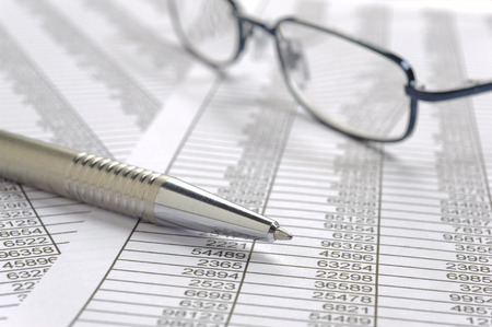 spread sheet: financial spread sheet with pen and glasses