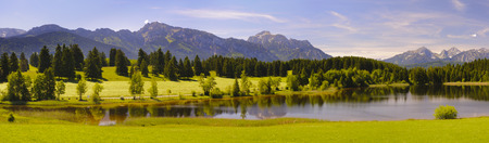 panorama landscape in Bavaria with lake and alps mountains at spring 写真素材