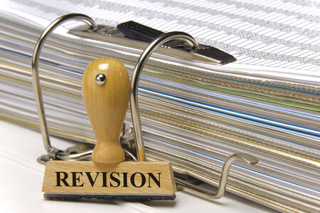 revision marked on rubber stamp