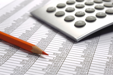 financial calculation with table chart and red pencil