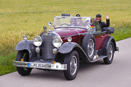 oldtimer: LANDSBERG, GERMANY - JULY 12, 2014: Public oldtimer rally organized by Bavarian city Landsberg for at least 80 years old veteran cars with unknown drivers in Mercedes K1570100, built at year 1926 Editorial