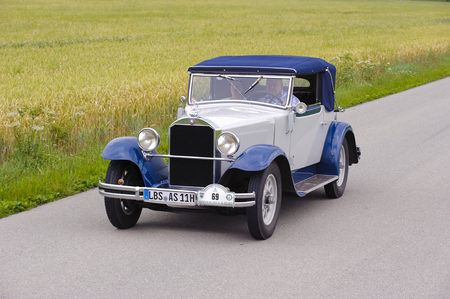 stuttgart: LANDSBERG, GERMANY - JULY 12, 2014: Public oldtimer rally organized by Bavarian city Landsberg for at least 80 years old veteran cars with unknown drivers in Mercedes Stuttgart, built at year 1930 Editorial