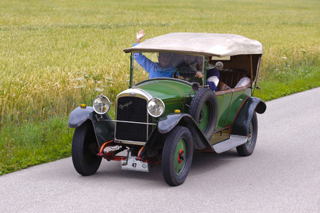 bl: LANDSBERG, GERMANY - JULY 12, 2014: Public oldtimer rally organized by Bavarian city Landsberg for at least 80 years old veteran cars with unknown drivers in Peugeot BL 177, built at year 1923