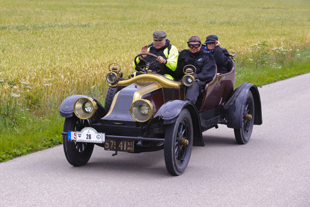 race car driver: LANDSBERG, GERMANY - JULY 12, 2014: Public oldtimer rally organized by Bavarian city Landsberg for at least 80 years old veteran cars with unknown drivers in Renault EF, built at year 1913