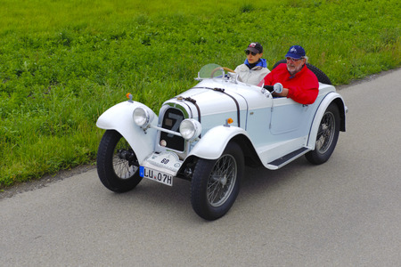 10 to 12 years old: LANDSBERG, GERMANY - JULY 12, 2014: Public oldtimer rally organized by Bavarian city Landsberg for at least 80 years old veteran cars with unknown drivers in Aero 10, built at year 1929