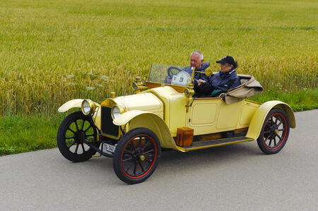 seater: LANDSBERG, GERMANY - JULY 12, 2014: Public oldtimer rally organized by Bavarian city Landsberg for at least 80 years old veteran cars with unknown drivers in Stellite open two seater, built at year 1915 Editorial