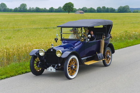 rally: LANDSBERG, GERMANY - JULY 12, 2014: Public oldtimer rally organized by Bavarian city Landsberg for at least 80 years old veteran cars with unknown drivers in Buick 45 D, built at year 1915