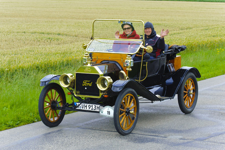 rally car: LANDSBERG, GERMANY - JULY 12, 2014: Public oldtimer rally organized by Bavarian city Landsberg for at least 80 years old veteran cars with unknown drivers in Ford T Torpedo, built at year 1911